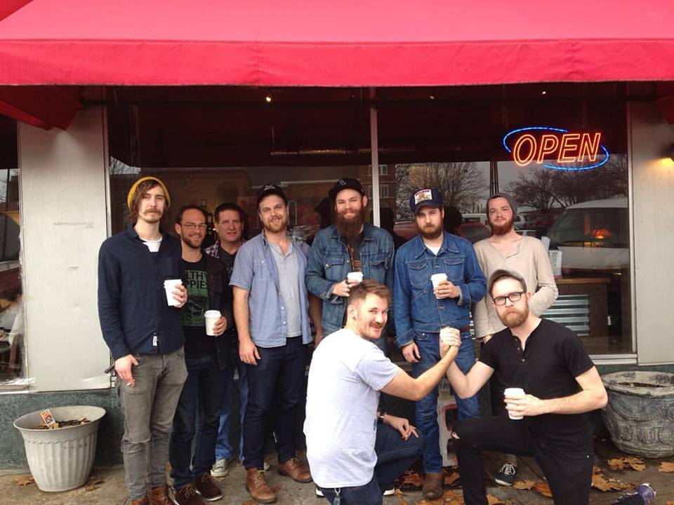 (L to R) Peyton Rodeffer of The Settled & Wilderness Alive, Phill Thompson of the Tombigbees, Craig Higgins of Lunar Lake, Alex Ingram of Lunar Lake & Cory Taylor Cox, Brady Gomillion of Cory Taylor Cox & Daniel Elias + the Exotic Dangers, JW Teller, Taylor McMillen of Lunar Lake, Cory Taylor Cox, Chris Heaton of Lunar Lake, in front of Rivertown Coffee Florence AL