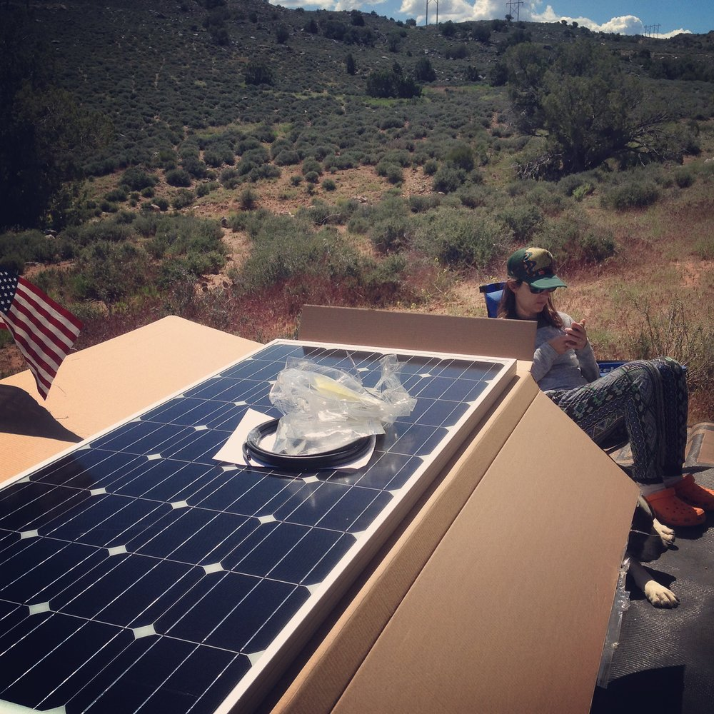 We added more solar panels to the array while in Moab around the Memorial day time of summer. Moab was awesome, until the heat hit. We were enjoying 80 degree days and 50 degree nights while boondocking on some BLM land. It was open range and the cows would bump up against the camper every morning that they pushed through the meadow. Utah has a grass known as cheat grass. It is the bain of every dogs existence in the area. Z got one between the ball and socket of his eye. The vile weed is barbed so its impossible to remove. Good times!!  First, the biting gnats came. Only you don't feel the bite, until about 12 hours later. I chose this time to ad a hitch to the front of my f350 to carry a little dirt bike. that meant laying on the ground for a few hours of gnat torture. then I also added some more solar power panels to the roof which was another afternoon of gnatastic fun. The next morning I awoke covered in large bites. Having a weird  natural pesticide since birth I have never really gotten any bug bites. I know its weird, everyone else gets bit but me, I'm just not tasty. So I have never had to develop any will power for scratching. By the end of the next few days, the hundreds of open wounds on my legs and neck had me looking every bit the meth head. Then the heat turned on. 104 by 11 AM? no thanks. They only sell 3.2 beer in utah? We are outta here. Silverton colorado and a campground at 10,000 feet next to a stream? Yes please.