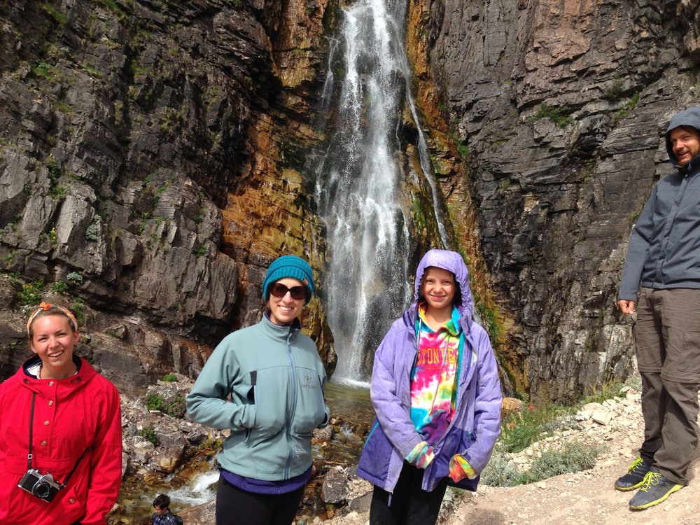 3 beautys at the falls in Glacier. and Nathan-the bro in law.