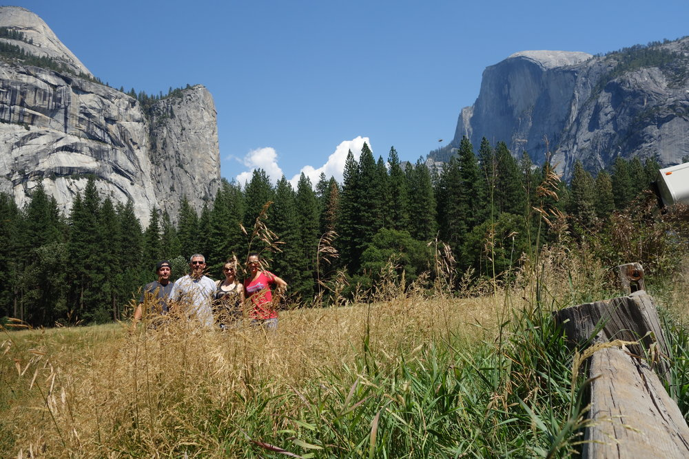 The heart of Yosemite. El Cap on the left and Half Dome on the right. Me, Paul, Rachael and Alicia hiding behind some grass. Our dear friends  Paul Kennedy  and Rachael Leman joined us in the Sierras. We had a blast exploring Yosemite and the sierras with them.