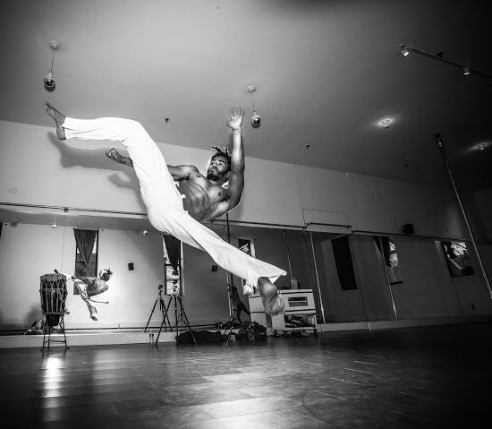 Instructor Pena Verde demonstrating a Capoeira kick called an Armada Martelo at Sacred Studio in Bed­Stuy, Brooklyn, where he teaches class (all levels) on Tuesdays at 6:00pm and Saturdays at 2pm. (Photo by Ace Murray / Brooklyn Juice Photography.)