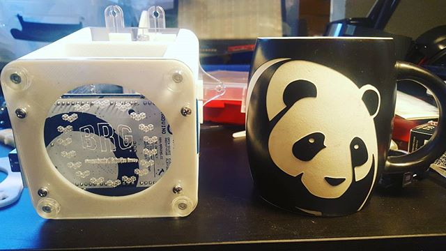 Coffee in the panda mug (as seen on the Kickstarter video) and the shameless branding of the Hobby Hand Base.  Cup was purchased at the Washington D.C. Zoo