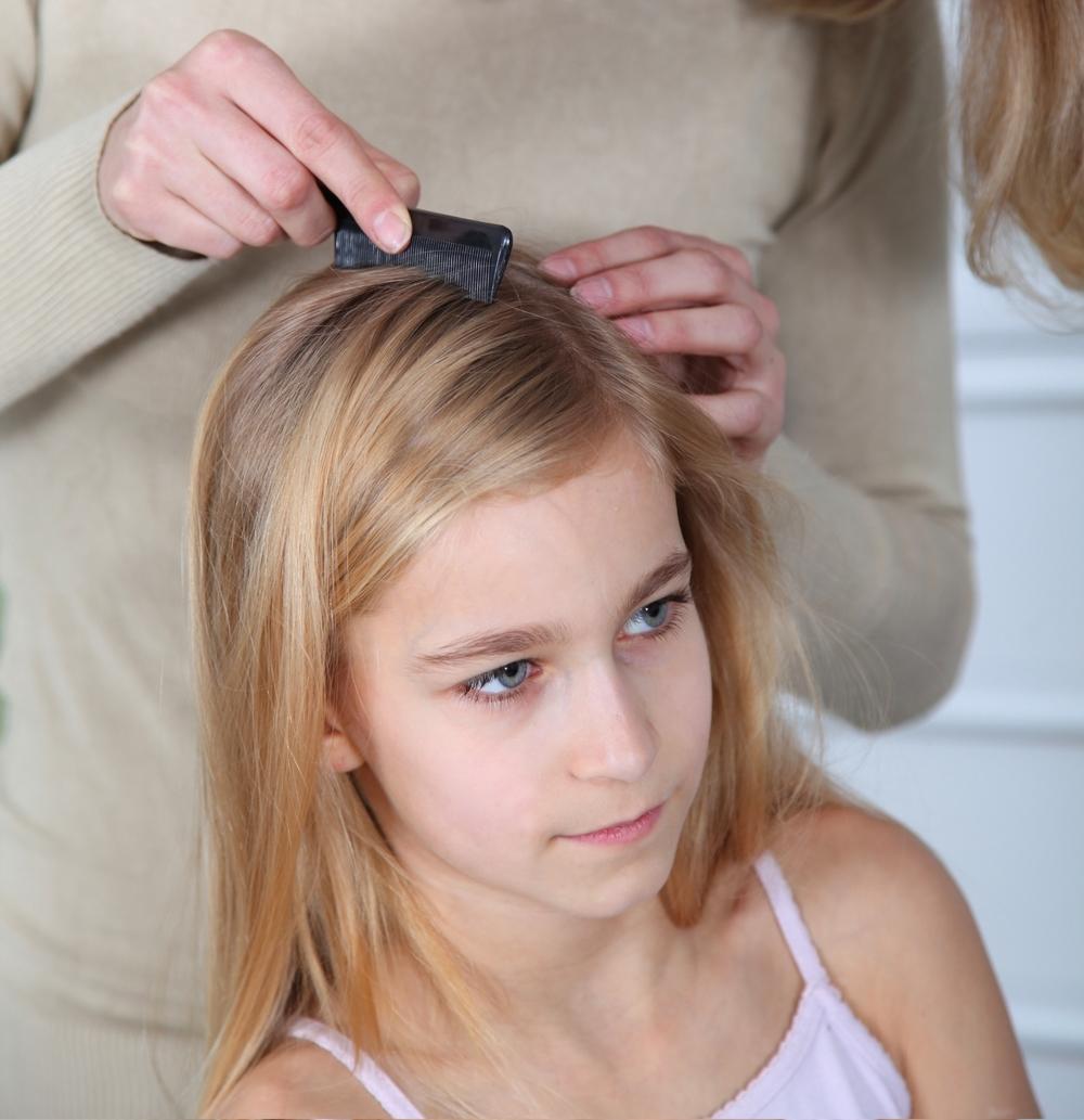 Woman combing lice.jpg