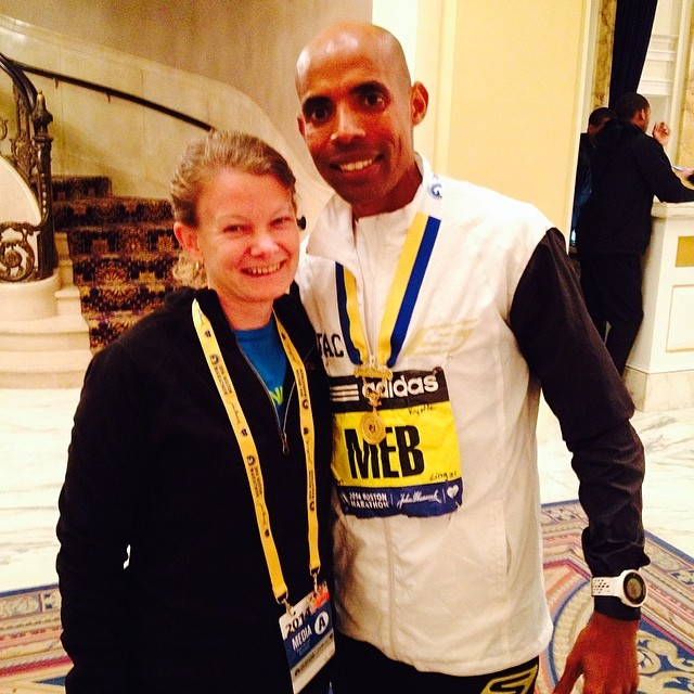 Perks of the press room? You get to greet the newly minted Boston Marathon champion—in 2014 it was Meb Keflezighi.