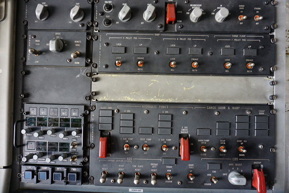 Control panel from the rear of a C5 Galaxy United States Airforce Cargo Jet. Symbolic of just how many buttons, connections, and complications an artist has.
