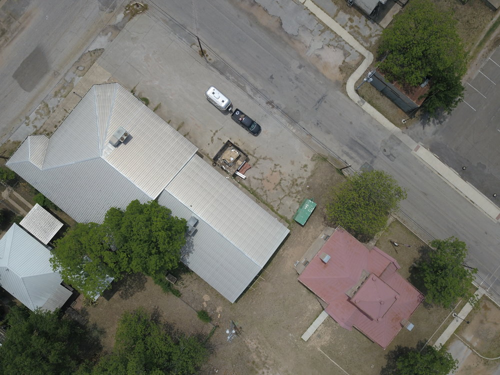 Drone shot of my truck and camper somewhere in Llano, Texas