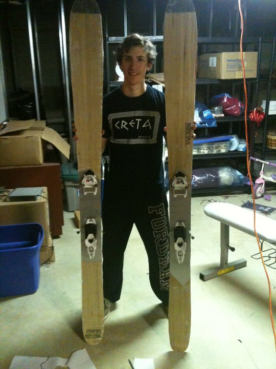 This is me, holding the first pair of pow skis we built. We named them Stormin' Norman.