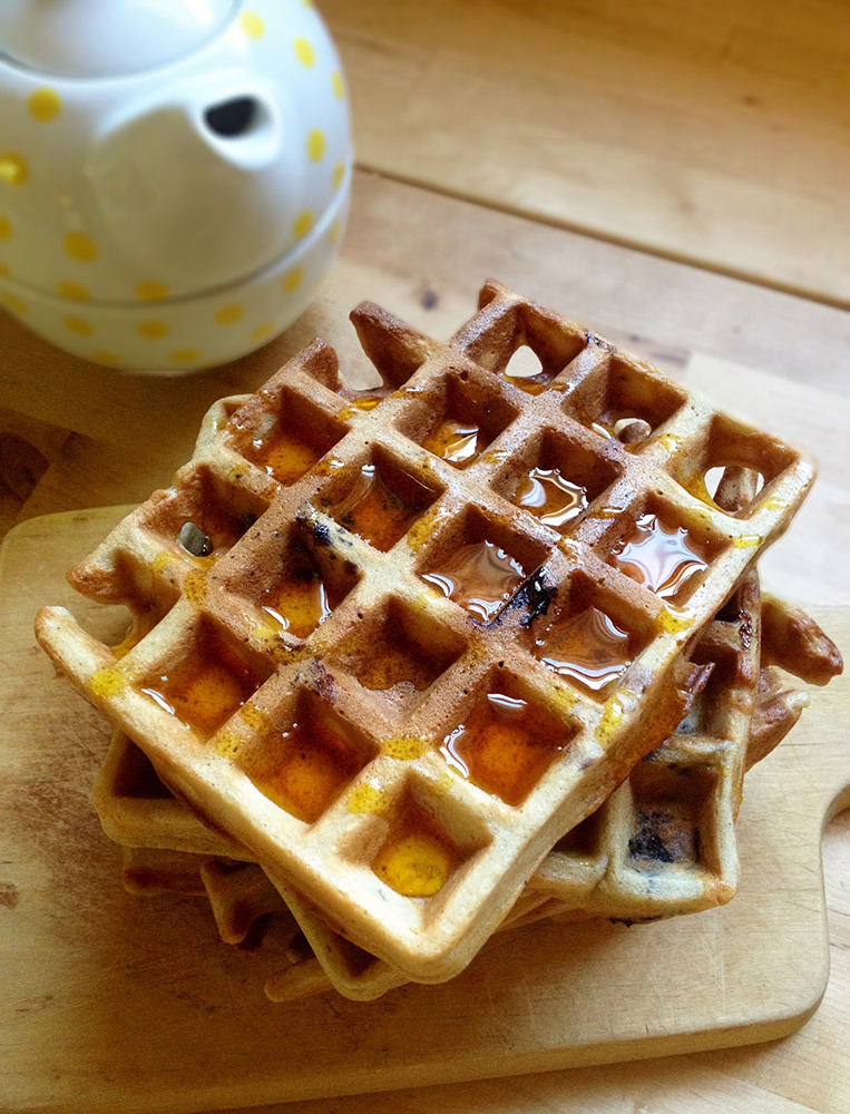 These are blueberry waffles with honey on top.
