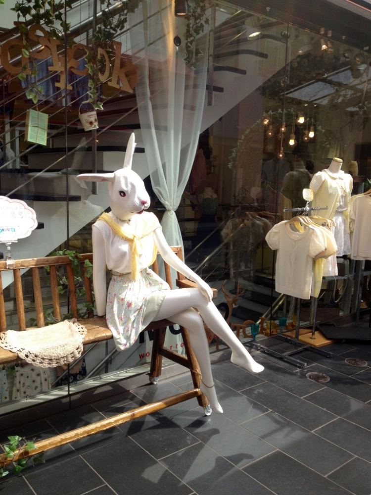 Cutely dressed bunny mannequin.
