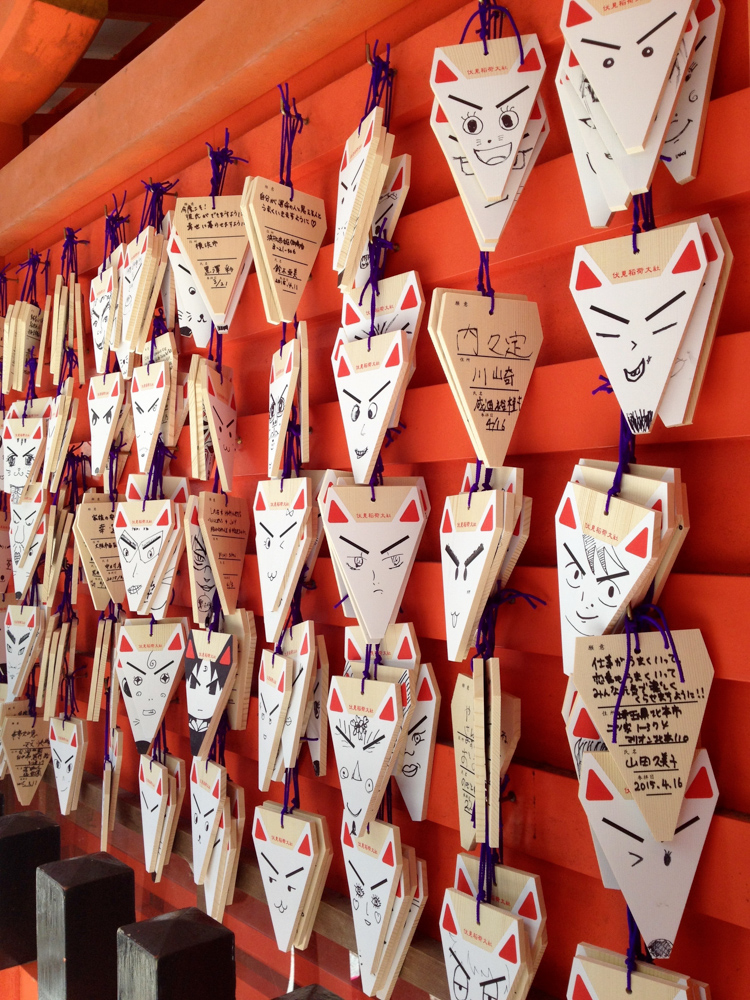 Fox-shaped 'ema' (wooden plaques for prayers and wishes) with funny faces!