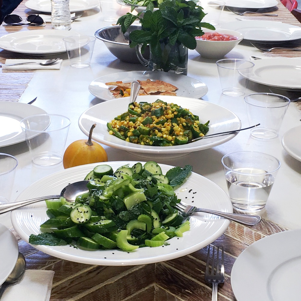 Salad with Persian cucumbers, celery and mint. Side dish with corn, okra, and spices
