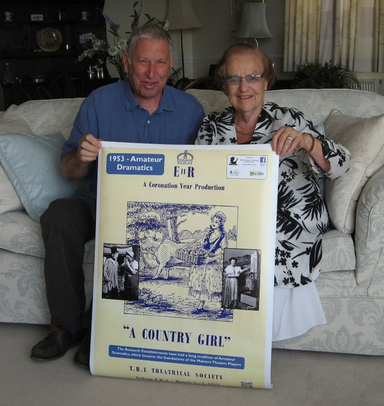 Mike Burstow and Heather Judson holding a copy of the poster she spotted herself in. Copyright MRATHS