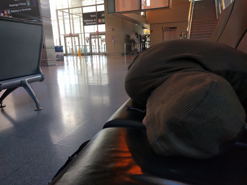 Brad Sleeping, BOS Airport, 2016