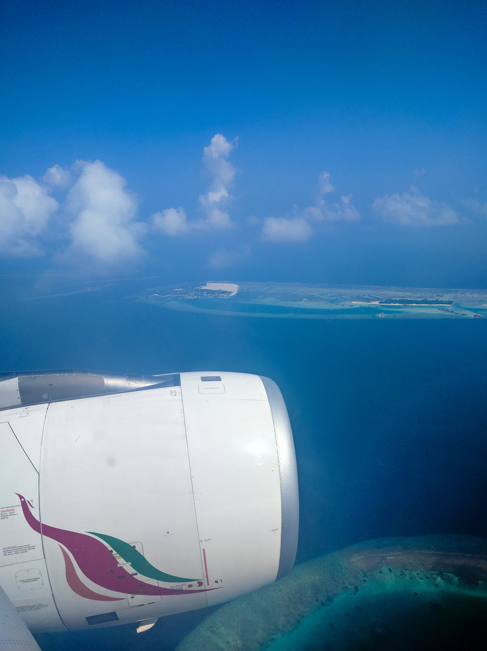 A pic from our decent into the Maldives. All of the islands were unique shapes and beautiful. Taken in 2016