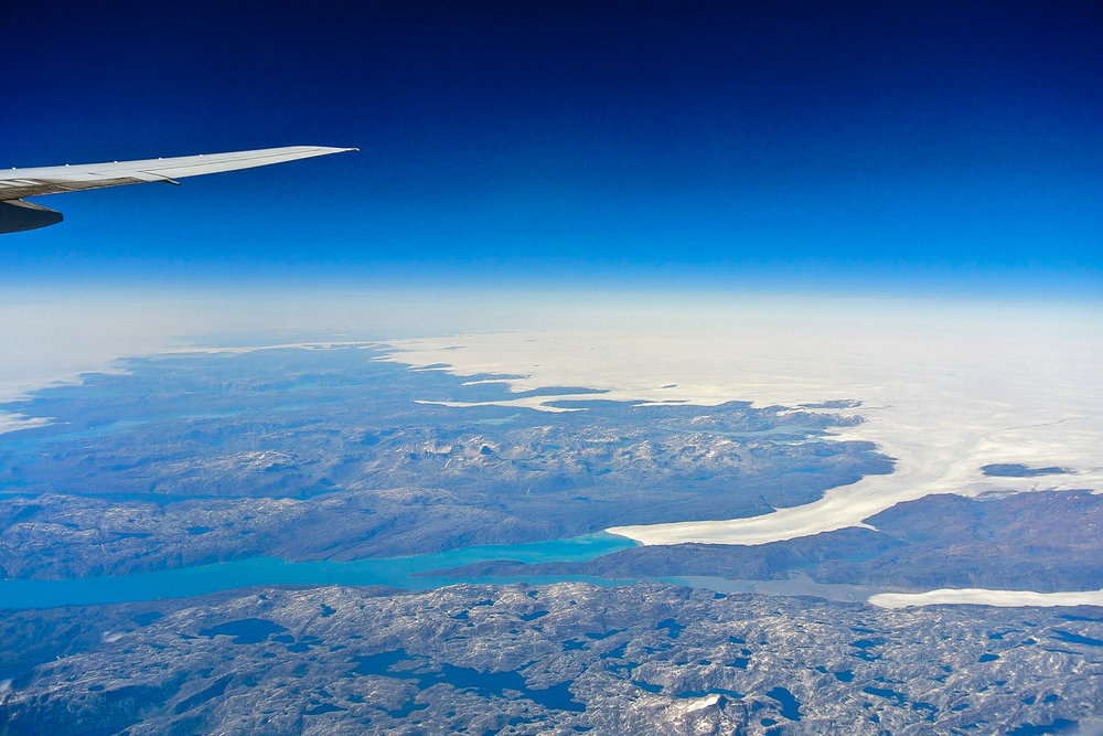 This was from our flight from London back to the United states when we flew over Greenland. It's the closest we have been to this country and it makes us want to go one day! Taken in 2012