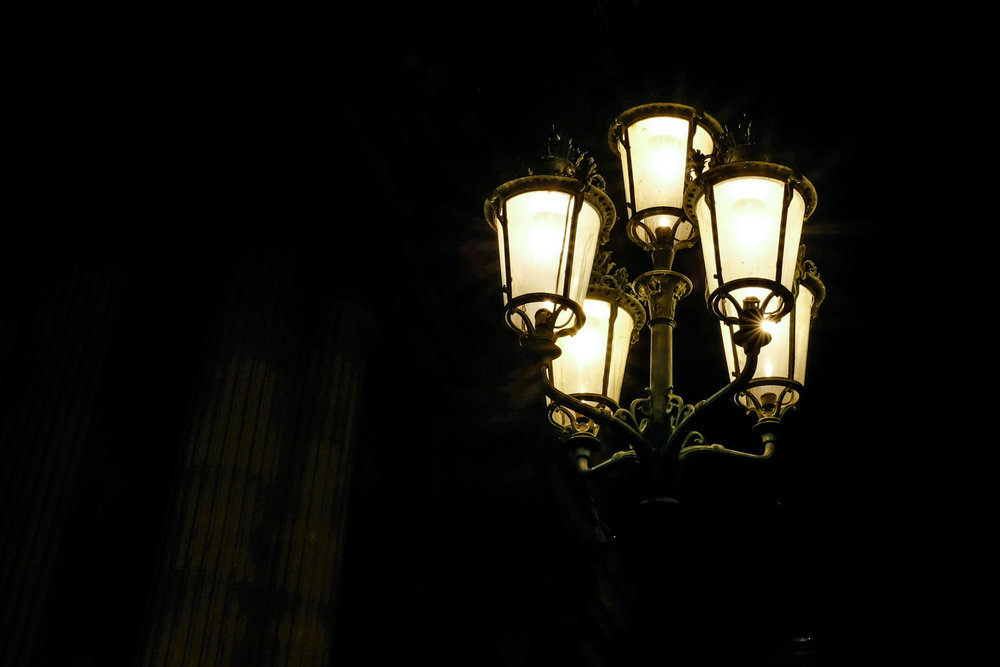 Street lamps with warm light.