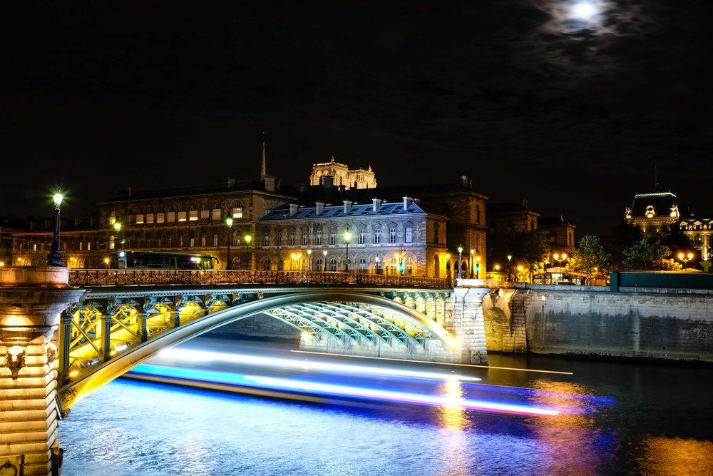 Illuminated bridge underbelly.