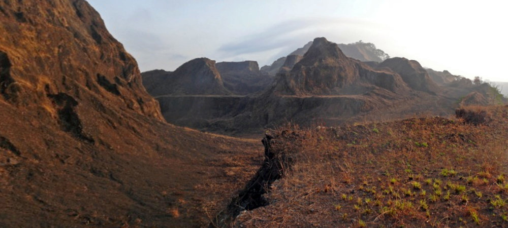 Scars from decades of intensive mining operations disfigure Mount Alpha in the Nimba Mountains, a global hotspot for biodiversity that continues to be threatened by expanding mining concessions. (Photo courtesy of Dr. Jean-Claude Koffi Béné)