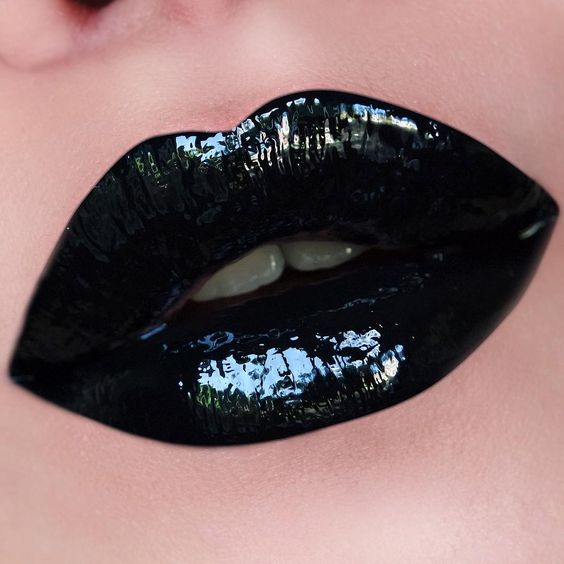 "Go gloss with a Patent-Leather look with this Who Is She Cosmetics Lip Composite in the shade ""Fierce"" by Larisa Lapre"