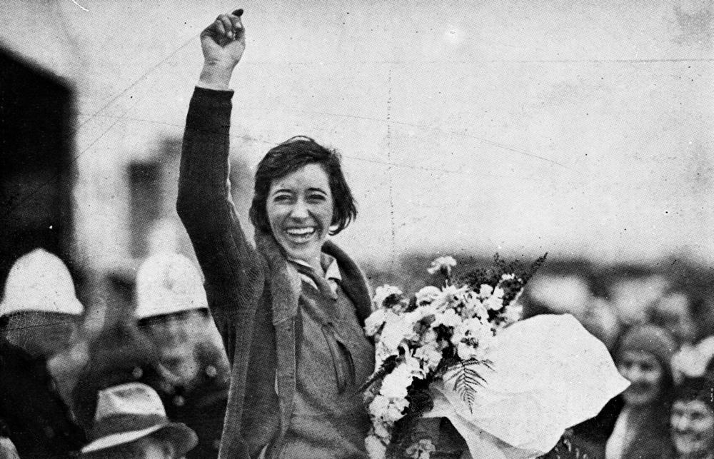 StateLibQld_2_195271_Aviator_Amy_Johnson_waves_to_the_crowd_after_landing_at_Brisbane,_1930.jpg