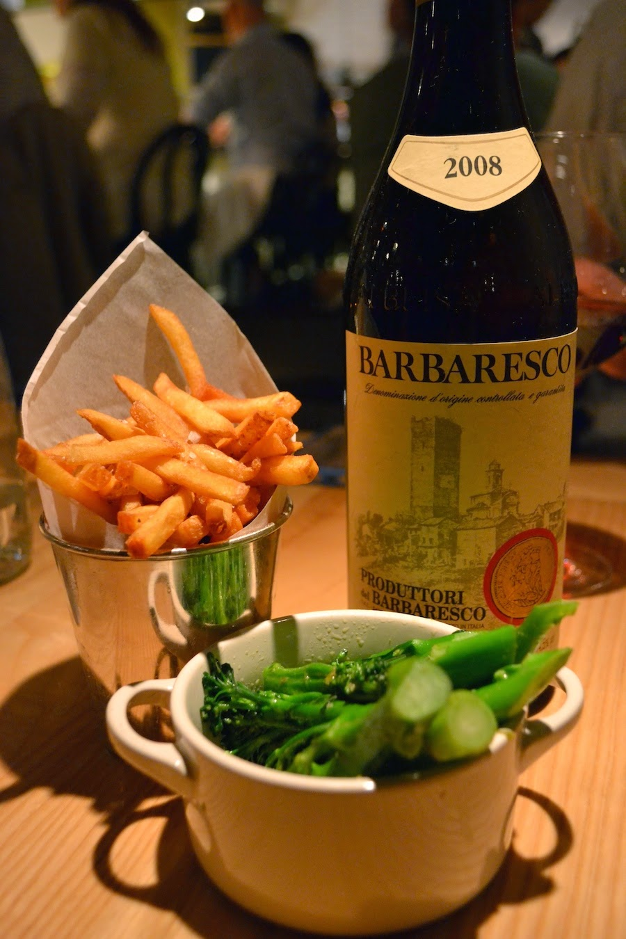 Our wine and sides of purple-sprouting broccoli and french fries