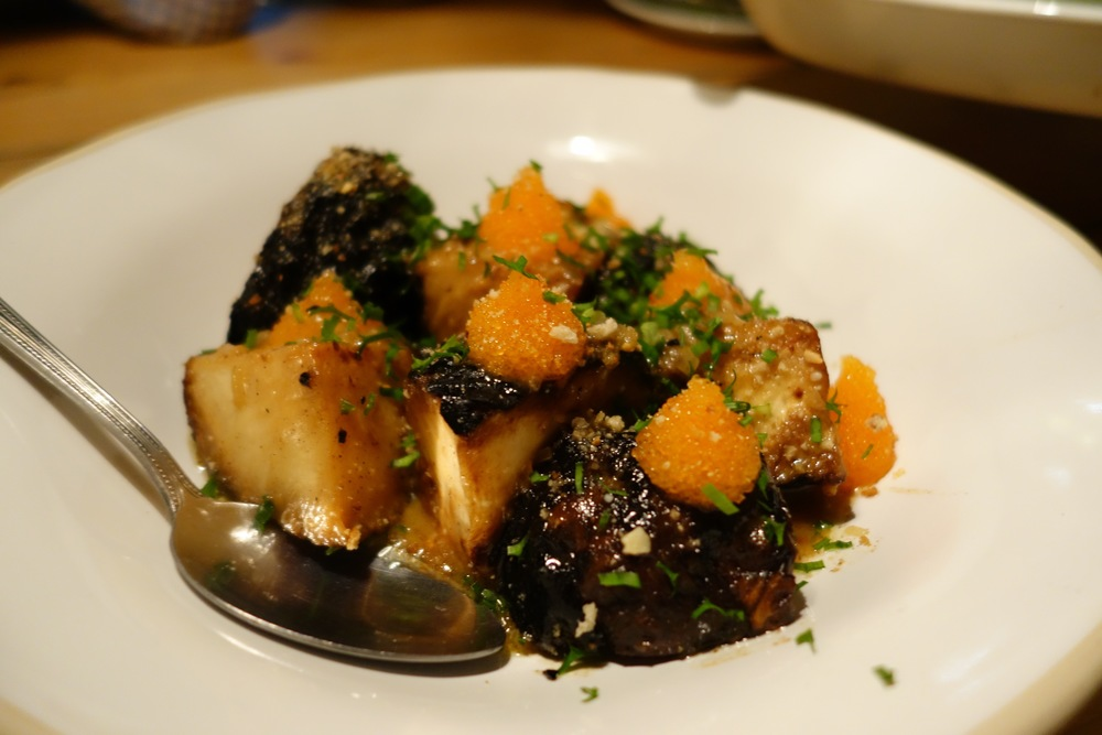 Grilled celeriac baked in cheese whey with bleak roe and chives, also by Oaxen Krog & Slip