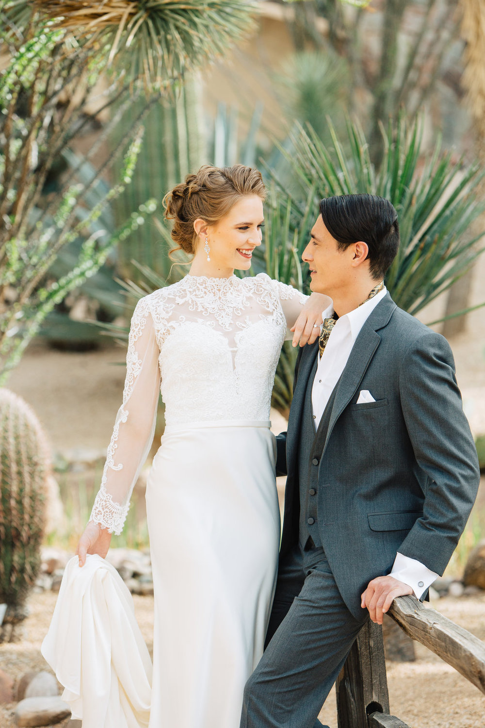 Bride, Groom, Phoenix Scottsdale Arizona Wedding Planner, Bridal gown, lace bridal gown, sleeved bridal gown, Groom attire, grey suite, southwest, ascot, groomsmen attire