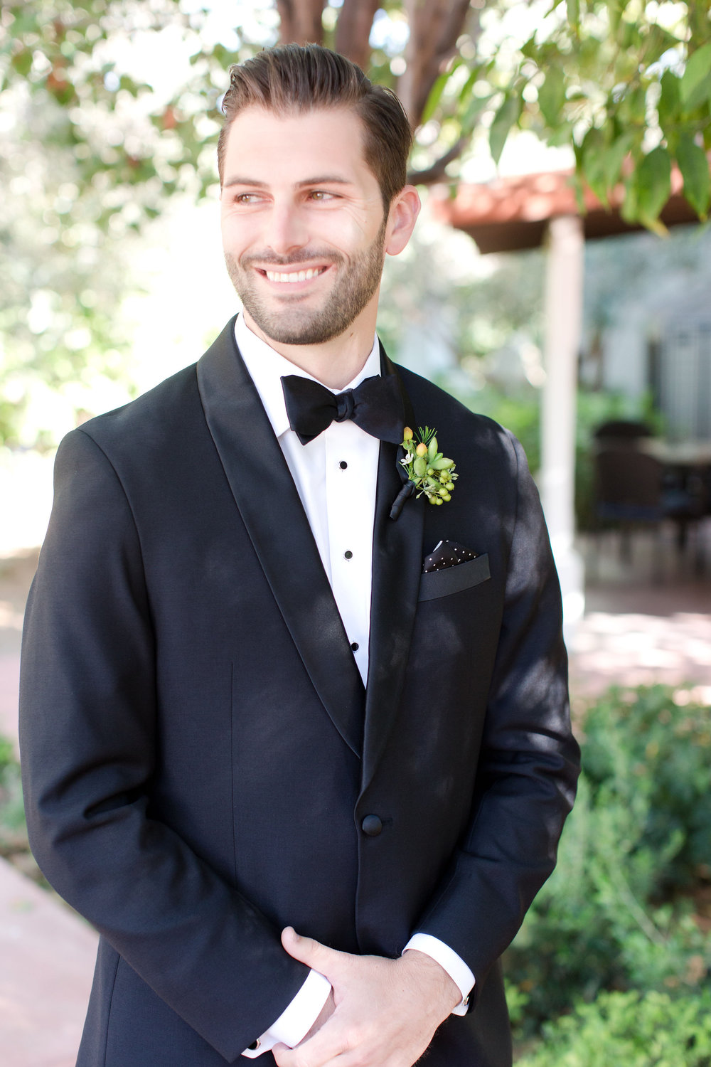 groom wedding details  , peach and mint wedding, blush and green wedding, Arizona Phoenix Scottsdale wedding planner, first look, black tux, boutonniere, desert wedding