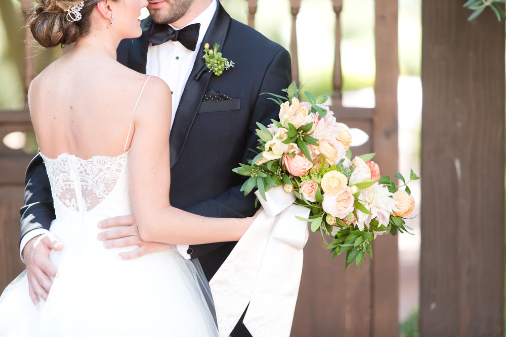 groom wedding details, peach and mint wedding, blush and green wedding, Arizona Phoenix Scottsdale wedding planner, first look, wedding dress, peach flowers, blush flowers, garden bouquet, boutonniere, black tux, desert wedding