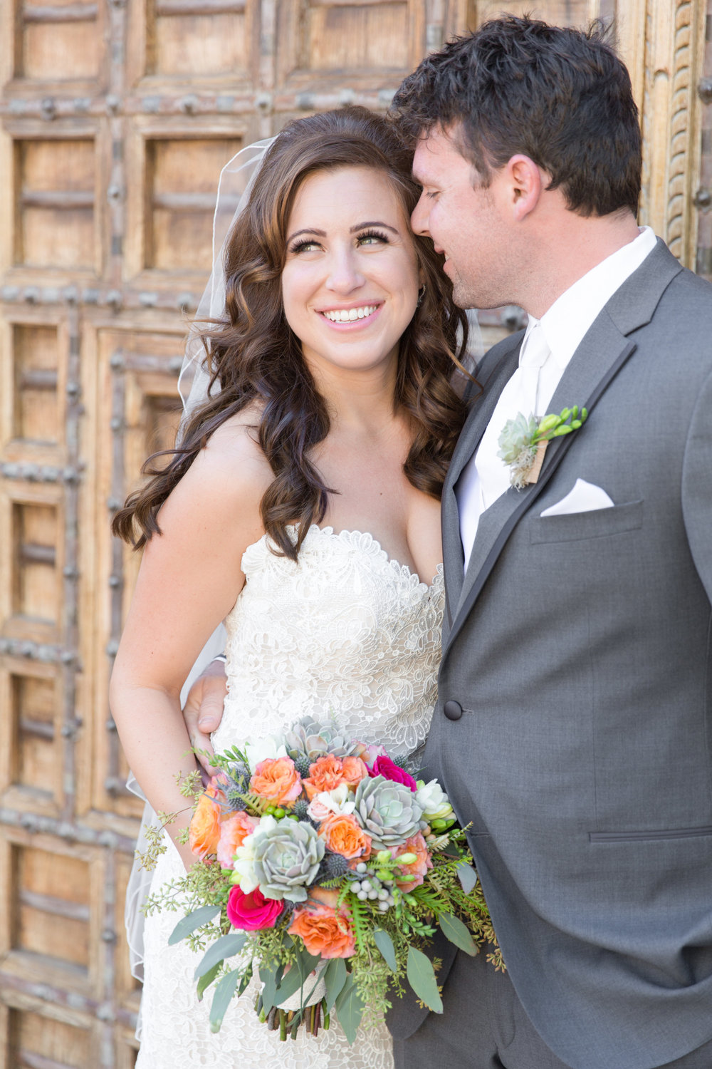 Phoenix-Scottsdale-Arizona-Wedding-Planner-Wedding-Venue-Destination-Wedding-Planner, Omni Montelucia weddings, sunset weddings, Arizona Sunset weddings, wedding details, bridal bouquet, succulent bouquets, orange pink blue green flowers, bride and groom, groom gray suit, gray suit wedding