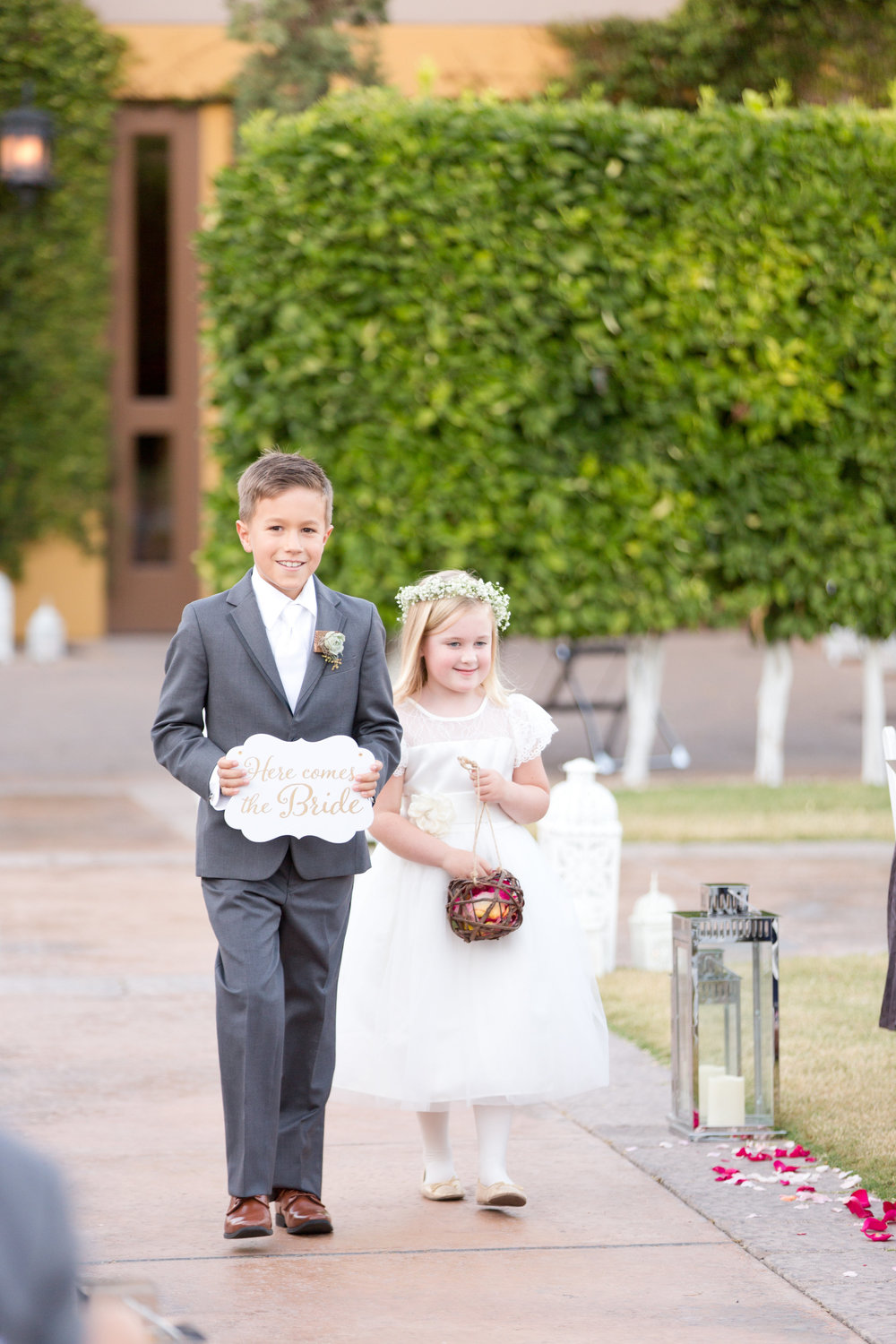 Phoenix-Scottsdale-Arizona-Wedding-Planner-Wedding-Venue-Destination-Wedding-Planner, Omni Montelucia weddings, sunset weddings, Arizona Sunset weddings, wedding details, bridal party, flower girl, ring bearer, ring bearer sign, wedding ceremony