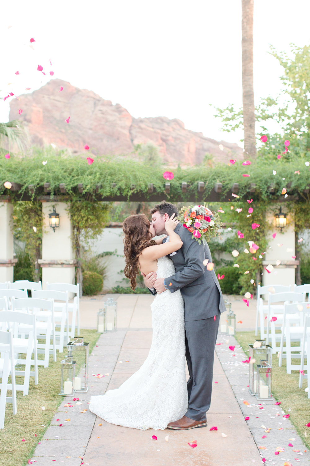 Phoenix-Scottsdale-Arizona-Wedding-Planner-Wedding-Venue-Destination-Wedding-Planner, Omni Montelucia weddings, sunset weddings, Arizona Sunset weddings, wedding details, bride and groom, wedding petal kiss, wedding petal ceremony kiss, ceremony kiss