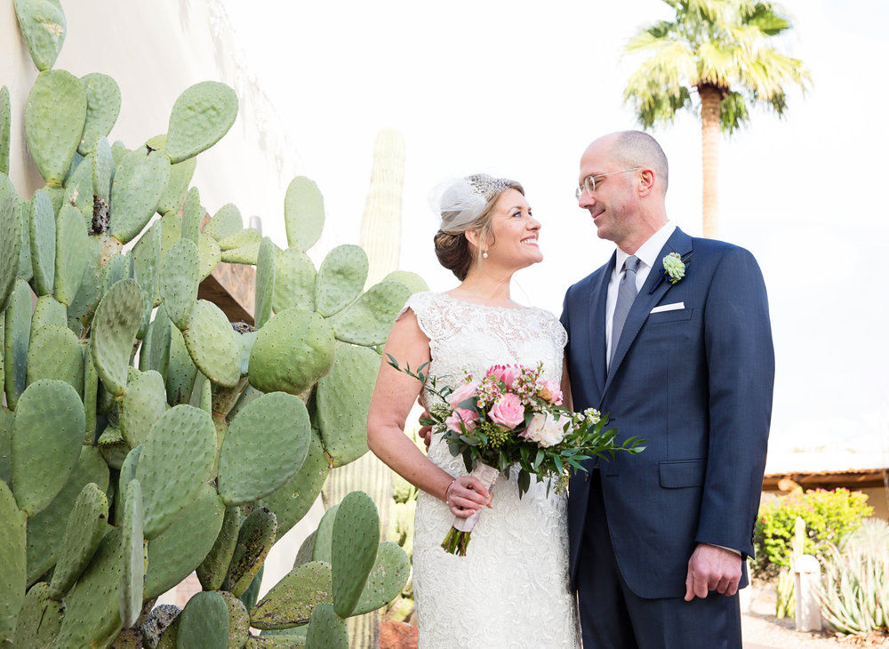 Arizona wedding, Camelback Mountain wedding, pink flowers, pink bouquet, pink wedding bouquet, protea, roses, succulents, desert inspired bridal bouquet, first look, lace bridal gown