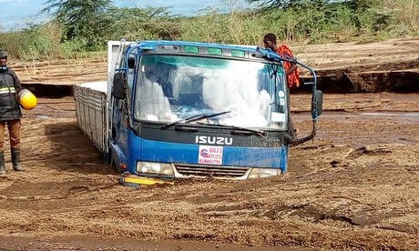 Isuzu truck stuck due to flash flooding -