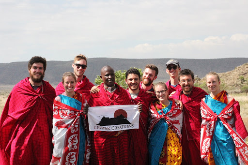 Our group posing with Daniel, dressed in traditional Maasai shukas -