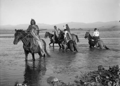 Horsemen_crossing_the_Los_Pinos_River.jpg