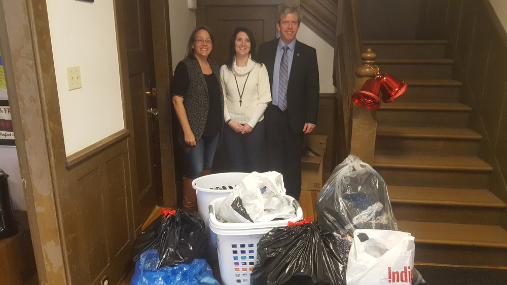 Marsha Tanner, Andy Langille and Sean Layden, Q.C. with the Lenehan Musgrave holiday donations