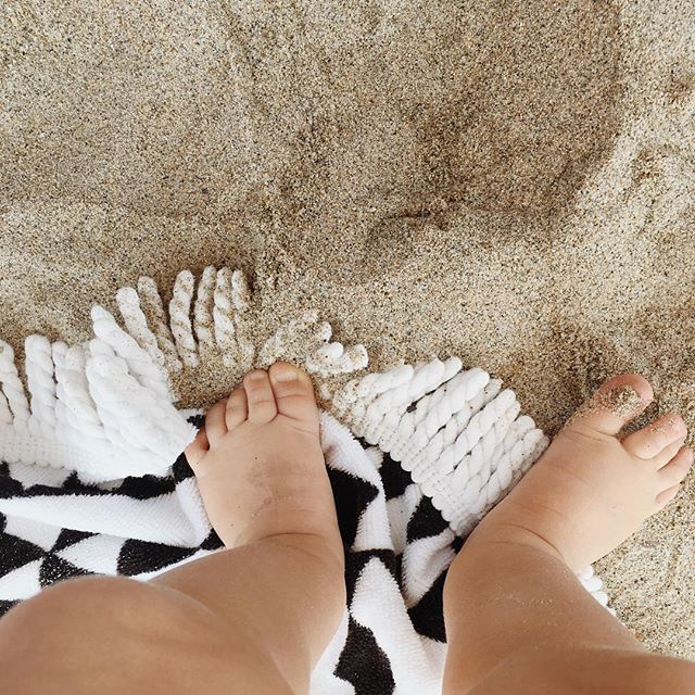 Can't stop staring at this photo of my baby's little sandy toes😍