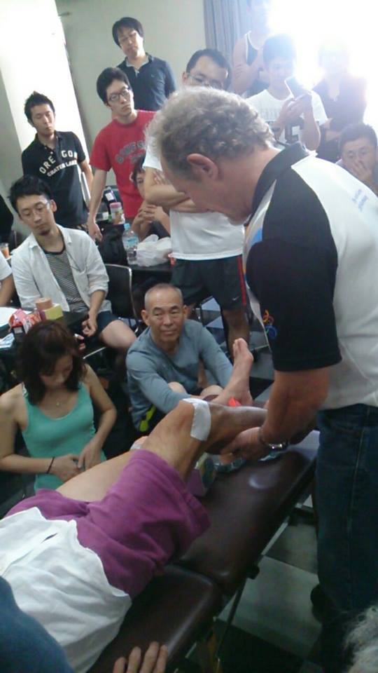Dr. Ray demonstrating advanced taping techniques for his International Sports Science diploma course in Tokyo, Japan