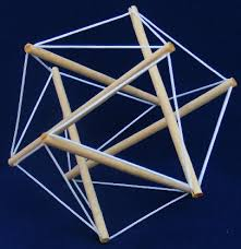 A simple tensegrity model comprised of 6 rods held together by a series of rubber bands all sharing the tension of the system, to maintain its shape, equally.