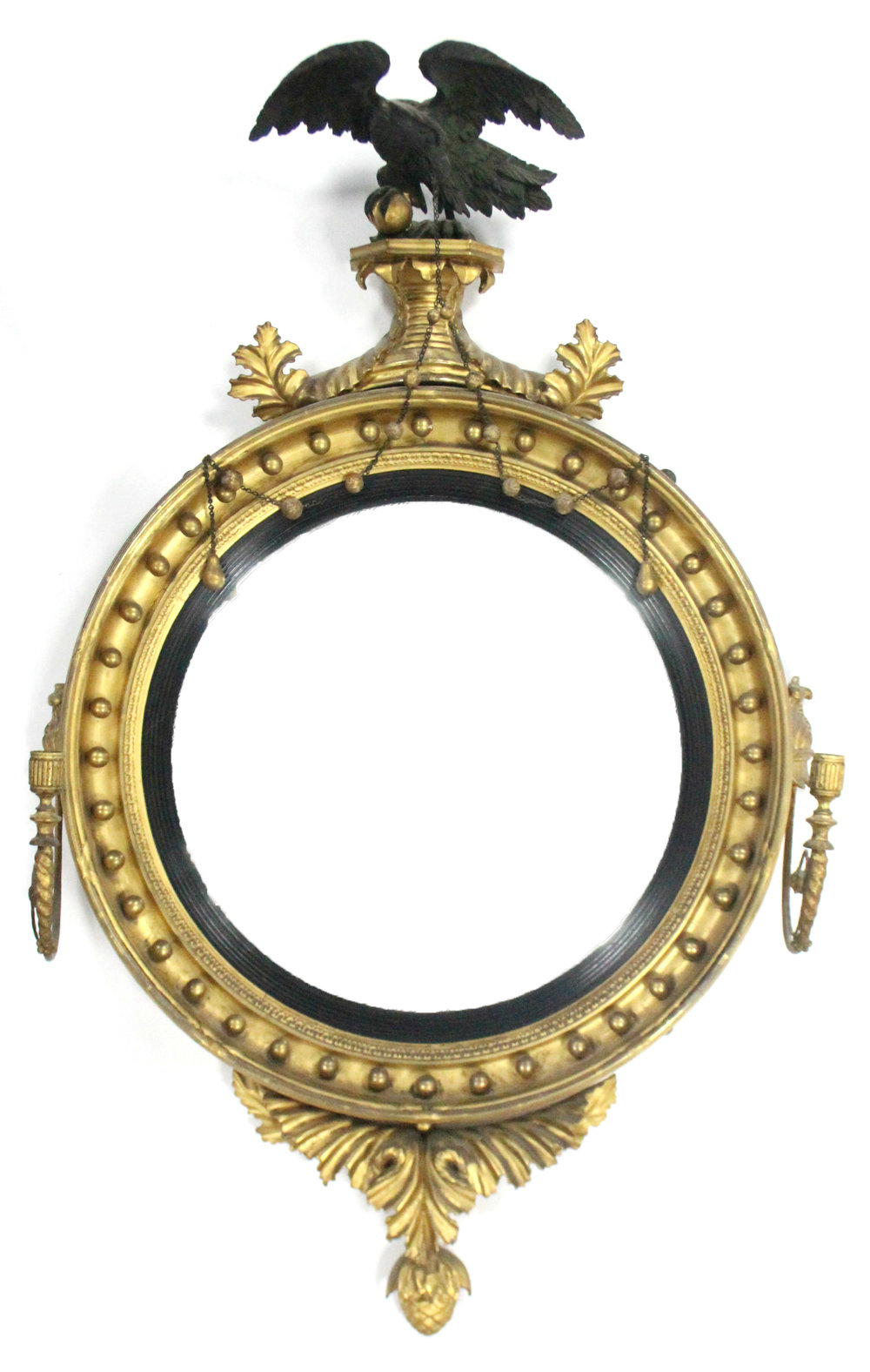 Regency giltwood twin-light convex wall mirror with ebonised eagle surmount