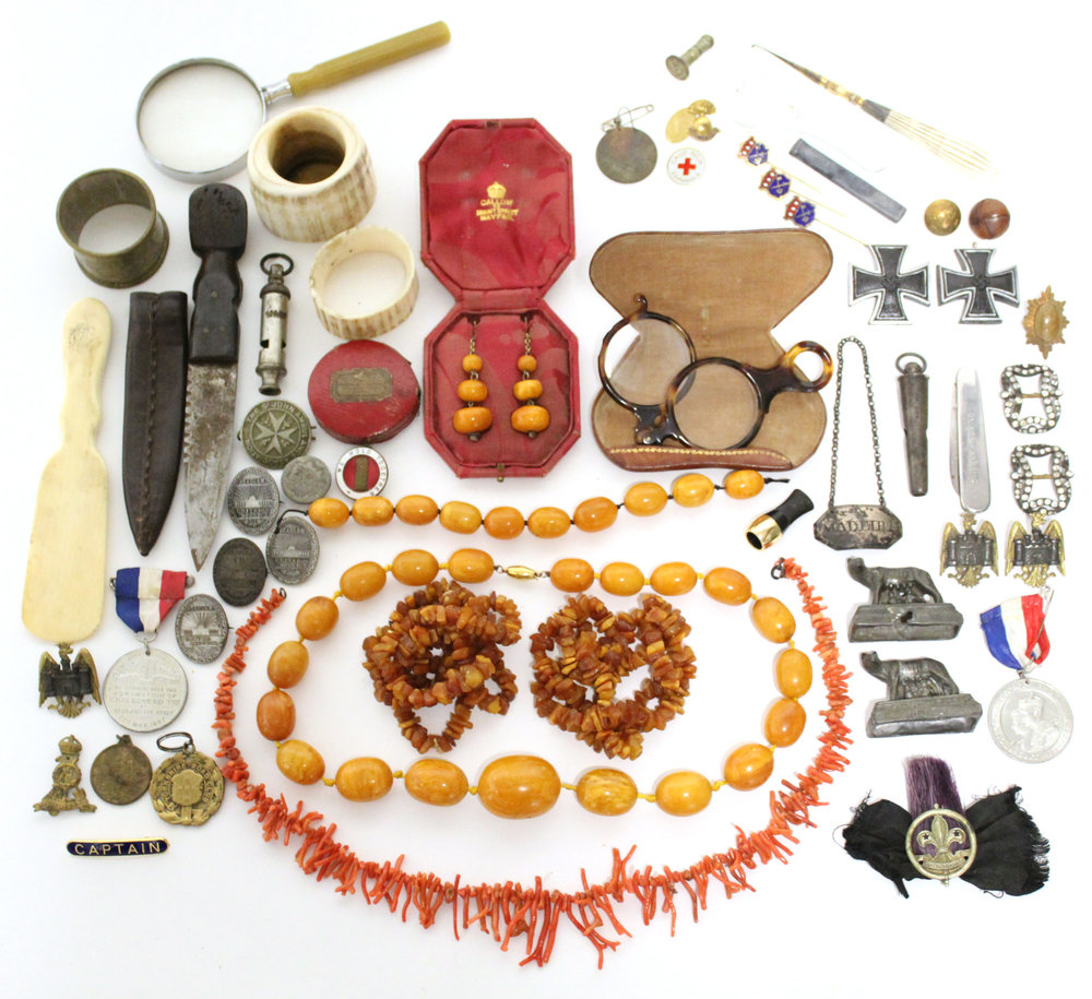 Sold For £2,300. A collection of amber, coral, & costume jewellery, badges, knives, etc.
