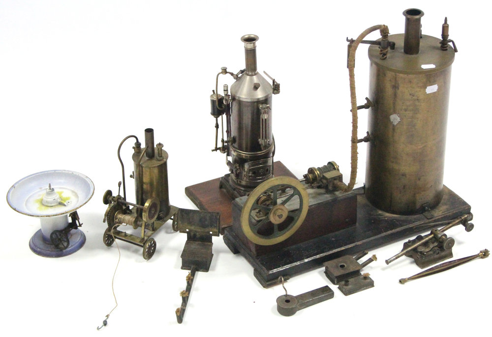 "Sold For £1,300. A brass scratch-built stationary steam engine, 16¾"" high; & two similar smaller ditto."
