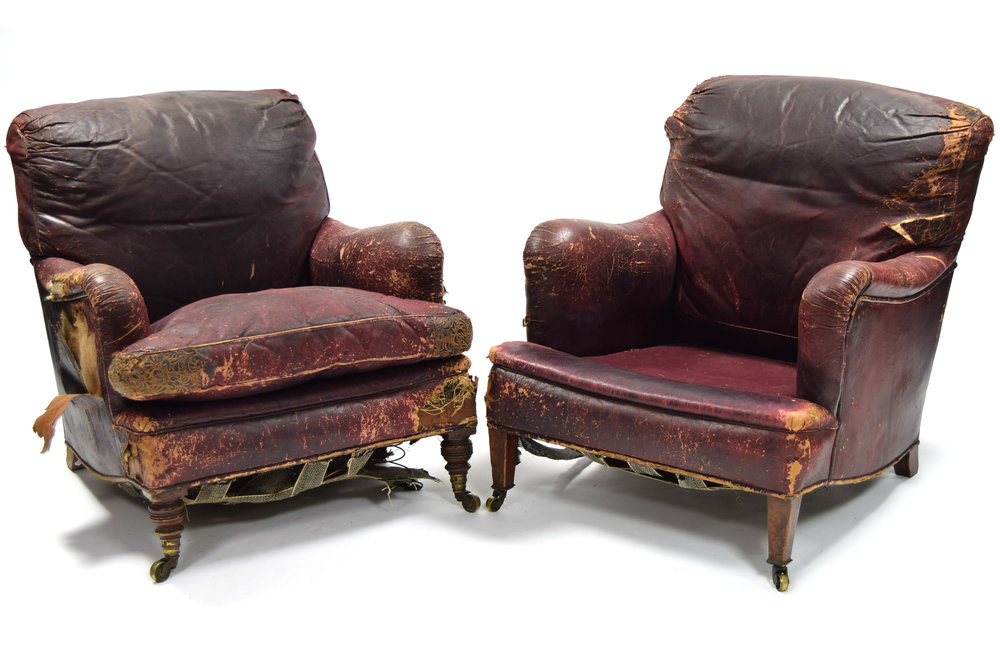 Sold For £5,400  A near-pair of leather armchairs by Howard & Sons