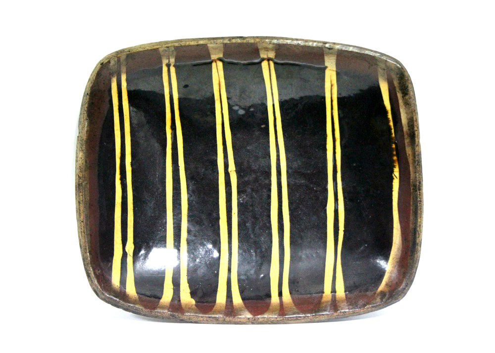 Sold For £3,000  An early English slipware dish