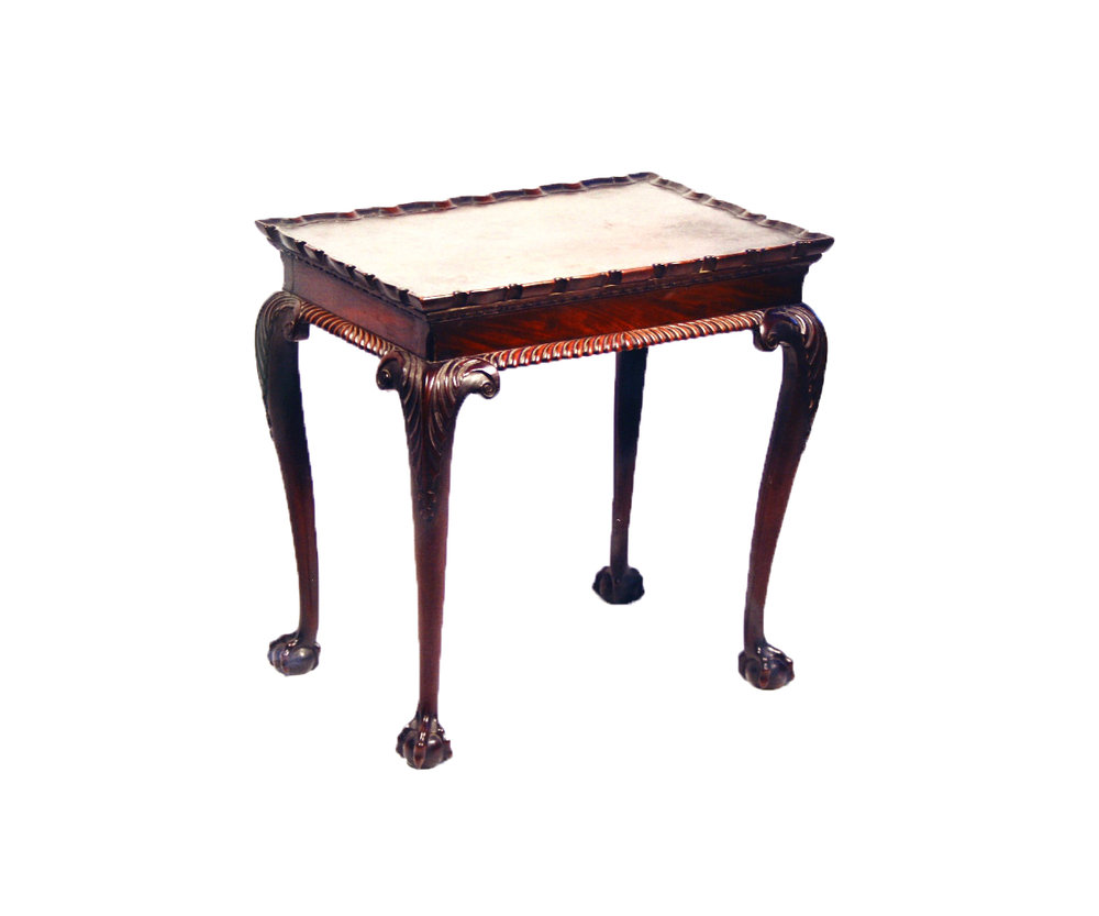 Sold For £30,000  A Chippendale period carved mahogany silver table