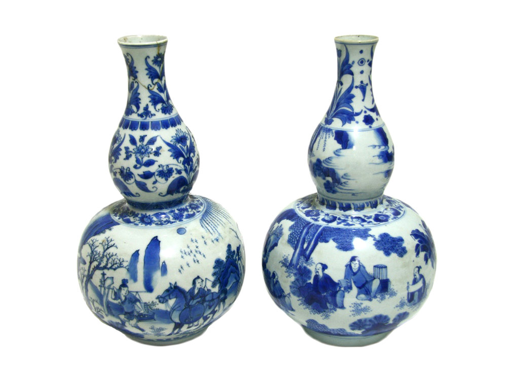 Sold For £9,000  A pair of Chinese porcelain double-gourd vases with underglaze blue decoration, Kangxi period