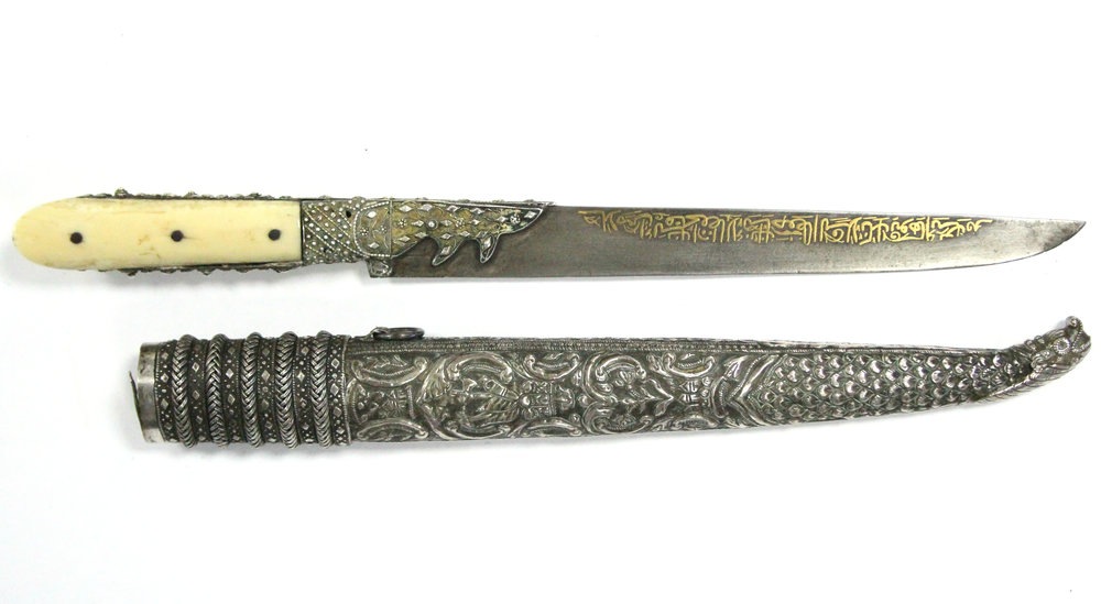 Sold For £920  A Persian ceremonial dagger