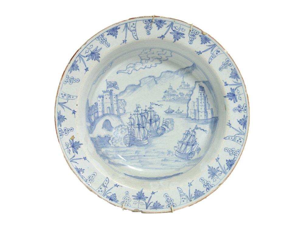 Sold For £5,700  A mid-18thC English Delft dish 'The Taking of Portobello'