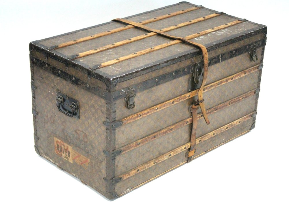 Sold For £7,100  Louis Vuitton steamer trunk with monogram decoration.